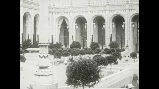 1910s: UNITED STATES: Tower over garden. Gothic fantasy building and architecture. Fountain of the Earth.