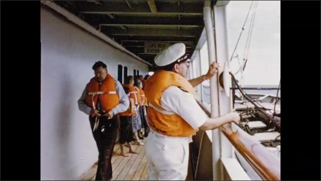 1950s: People on ship deck, lifeboat lowers next to deck. Dissolve, people on ship deck, woman walking with kids.
