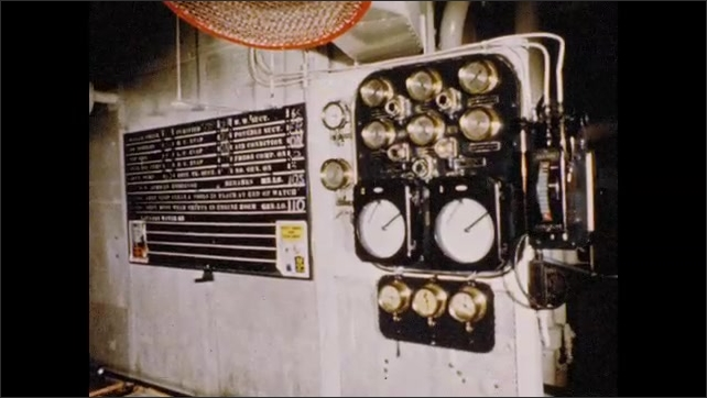1950s: View of dials on wall. View of dials, chart on wall.