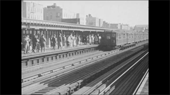 1940s: Passengers and vehicles disembark from ferry.  Train station.  Passengers enter train cars.