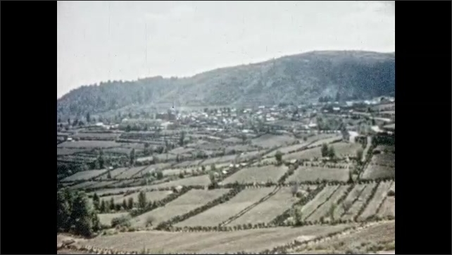 Mexico 1950s: Fields and village in valley.