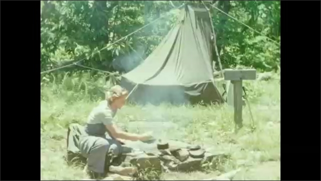 1940s: Woman pours oats into pan over campfire. Woman stirs pot over campfire. Woman places lid on pot.