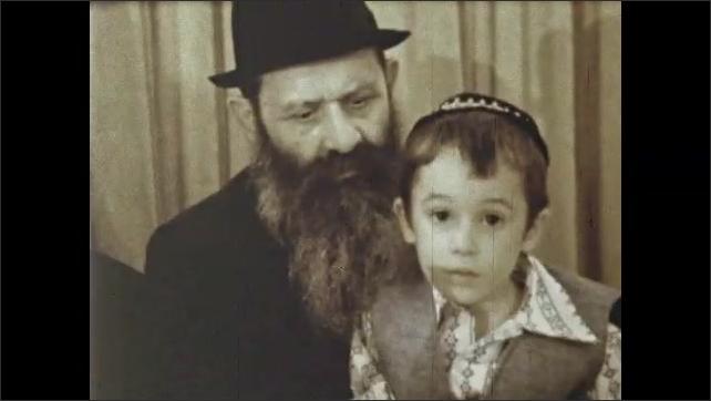 1970s: Jewish men, women and children dance and celebrate at wedding.