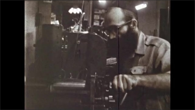 1970s: Men type at typewriters. Men work with machinery, use hammer, turn knob, assemble parts, use tools.