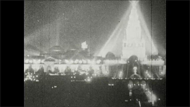 1910s: Tower of Jewels at day and night. People walk.