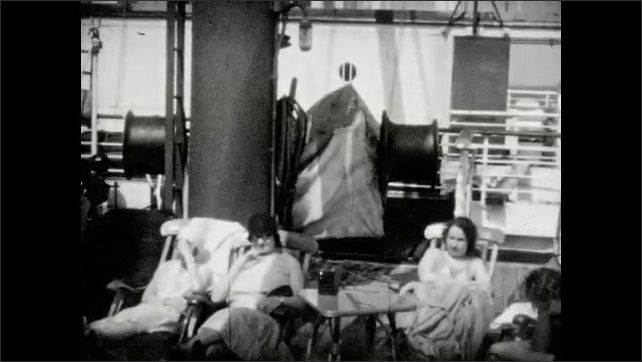 1930s: Passengers relax on deck of ocean liner; two ladies pose in period fashions; boxers spar in onboard ring for audience of passengers.