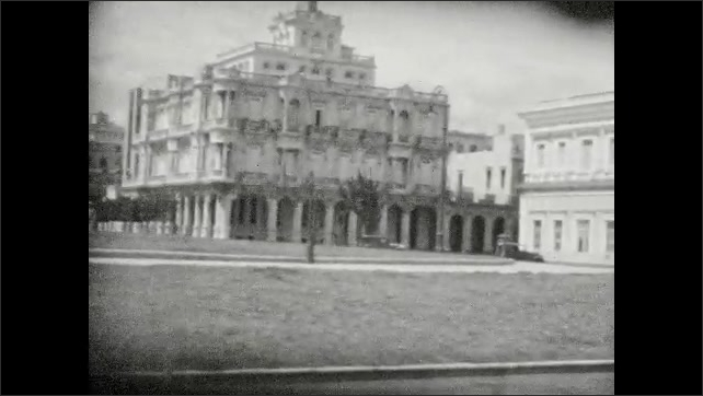 1930s: Views of Columbus Cathedral, stately buildings, public plaza in Havana, Cuba.
