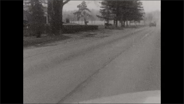 1950s: Views from windshield as car travels through commercial, then rural neighborhoods.