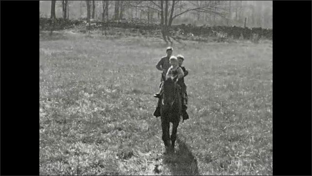 1950's: Small boys ride pony across yard; lambs graze by steps of farm house.