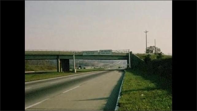 1960s: Views of interstate highway, signage.