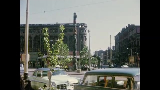 1960s: Views of totem pole in downtown setting.