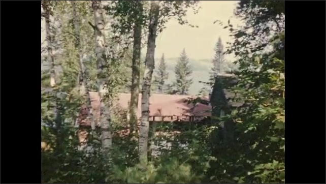 1940's: Car passes along dirt road among dense woods; views of Lake Damariscotta.