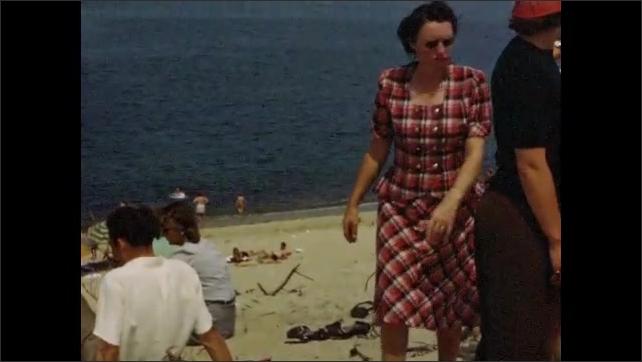 1940s: Tourists enjoy beach on Cape Cod; Provincetown Inn parking lot with black automobiles.