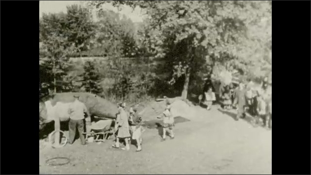 1950s: Children visit park with life-size dinosaur models.
