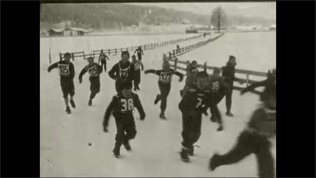 1950s: Children in Germany skate around village on glide shoes.