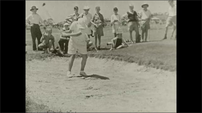 1950s: Boys participate in golf tournament as dads serve as caddies.