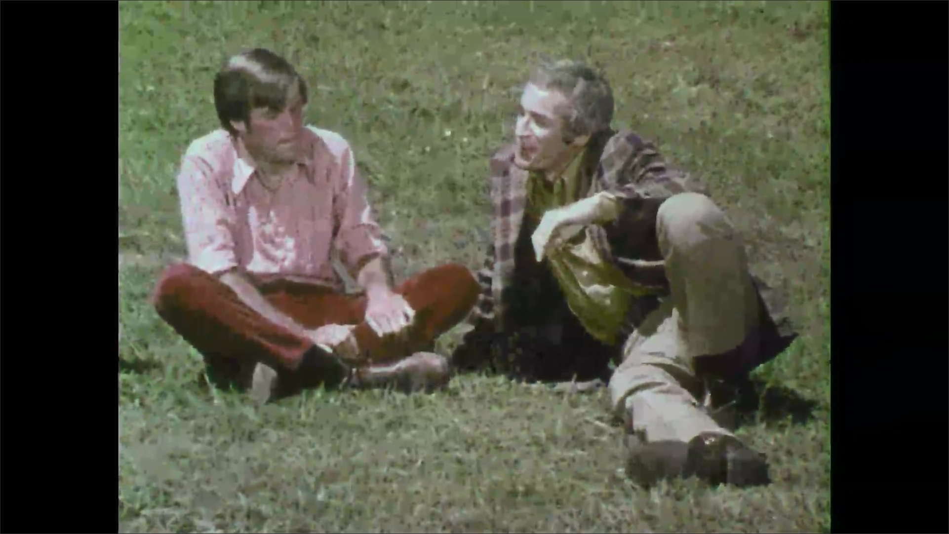 Group of 1970s students sits on grass in discussion with teacher. Boardroom meeting with presentation. Blueprints.
