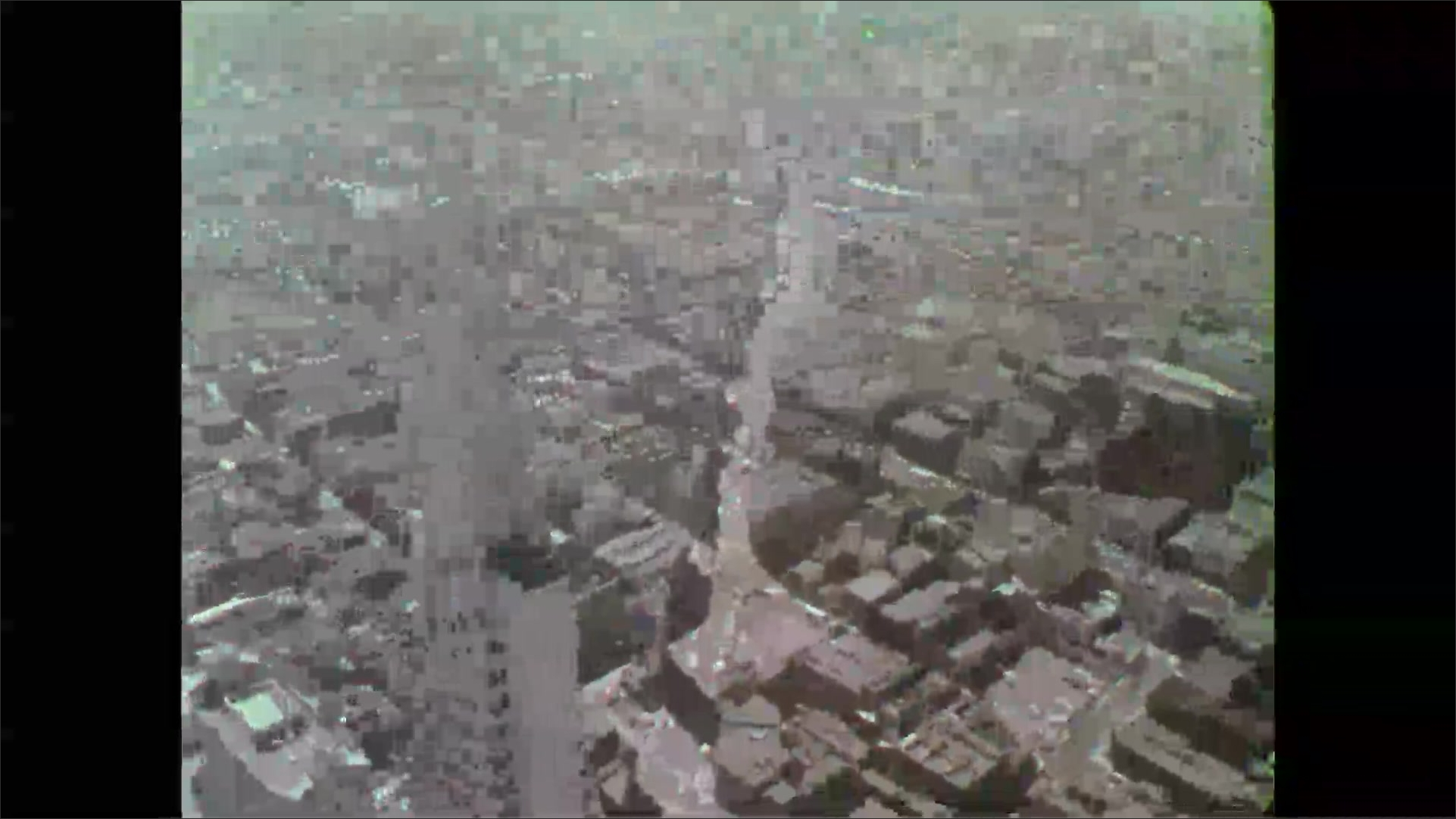 Aerial view 1970's cityscape, office buildings and skyscrapers.
