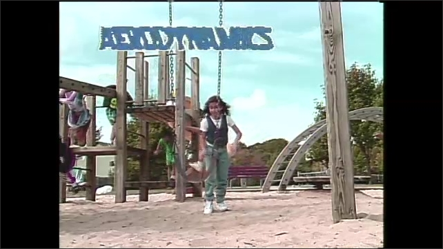 1990s: Girl stands on playground talking while other children play. Words appear as girl plays on swing. Girl plays with kids on teeter-totter. Intertitle.