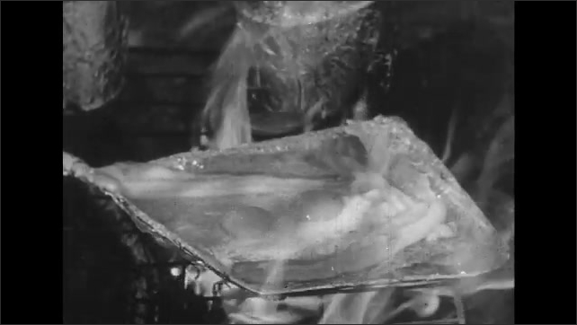 UNITED STATES 1950s: Man puts food in freezer / Man shuts freezer door, walks off screen / Bacon and eggs cook on campfire.