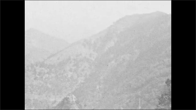 1930s: UNITED STATES: terraces on steep slope. Trees on mountain side. Ridge of mountain. View along valley.