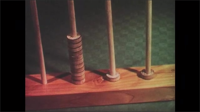1950s: UNITED STATES: stop motion filming of abacus counters moving on abacus