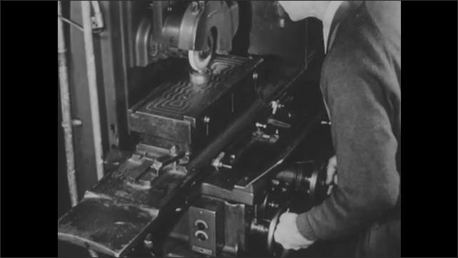 1940s: UNITED STATES: man pushes switch on motor. Push button station. Man turns wheel. Man presses start button.