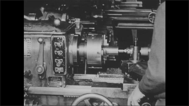 1940s: UNITED STATES: across the line starter. Magnetic starter button. Hand starts and stops motor on machine. Forward button energises contacts