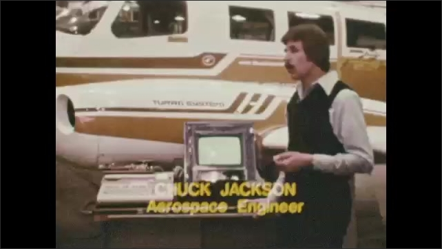 1970s: UNITED STATES: plane flies in sky. AMES Research Centre. Aerospace engineer speaks to camera. Man stands by plane.