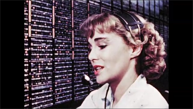 1940s: Woman speaks into headset and operates telephone switchboard. Puppet holds telephone receiver. Man in uniform answers telephone.