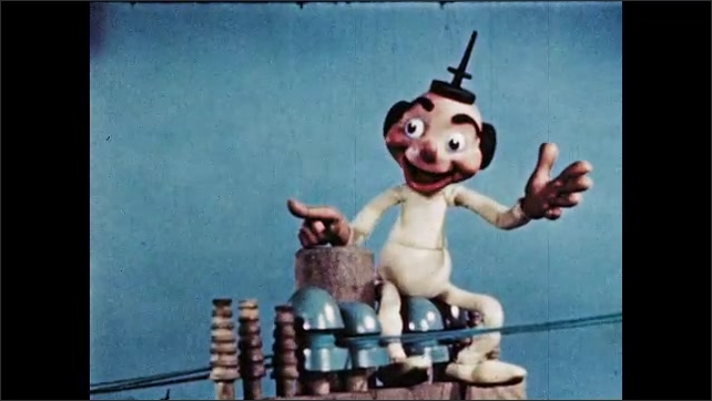 1940s: Boy pets and hugs dog. Puppet talks on telephone lines and waves. Puppet skates along telephone wires.