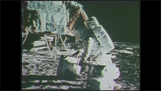 1970s: Split screen, photos of astronaut on moon, astronauts training. Photo of astronaut on moon. Tracking shot, driving on lunar surface.