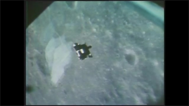 1970s: Footage of lunar module launching. Aerial view of moon surface. Views of module orbiting moon.