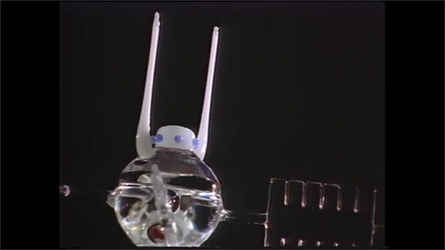 1990s: glass helicopter with working rotor and glass satellites, glassblower in workshop