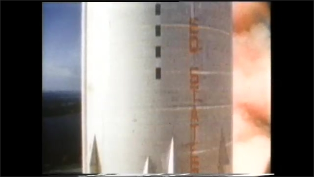 1990s: Rocket launches from pad into space. Back stage of rocket separates in orbit, falling back to Earth.