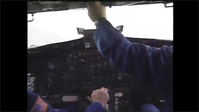1990s: Graphics on computer screen. Men sit in aircraft. Pilots pilot aircraft. Clouds.