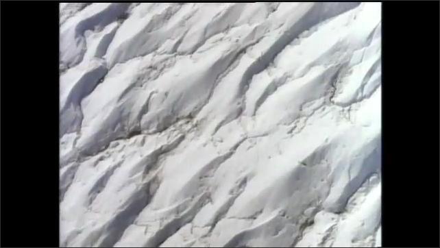 1990s: Glaciers and ocean. Man talks.