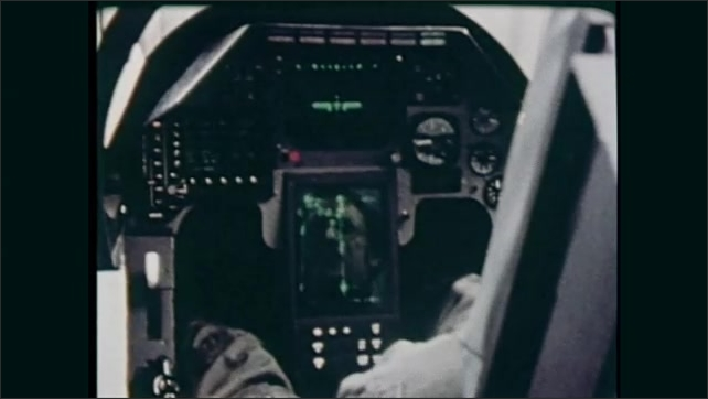 1980s: Computer screen with plane and markings. Jet flies in sky. People work on aircraft. Man sits in cockpit, presses buttons. Aircraft navigation screen.