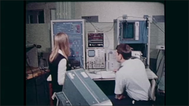1980s: Man and woman test equipment.