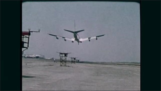 1980s: Plane crashes in desert. Plane flies in sky. Plane takes off from runway.