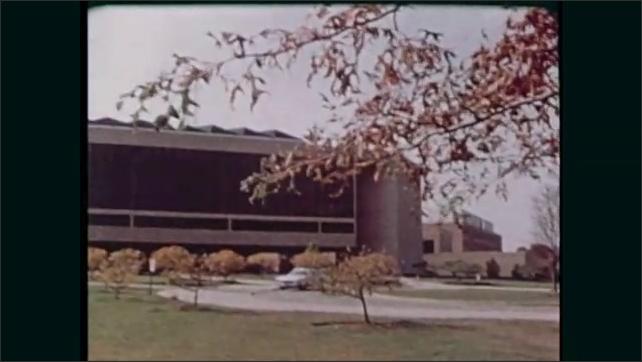 1980s: University of Dayton sign. Ohio State University sign. Wright State University sign. Buildings. School of Engineering sign. Man walks down path.