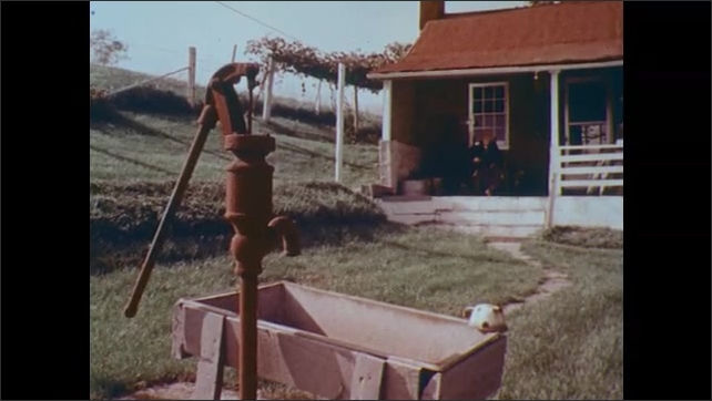 1970s: UNITED STATES: Side view of man's face. Man sits in rocking chair on porch. View across garden towards man on porch. Water pump in garden.
