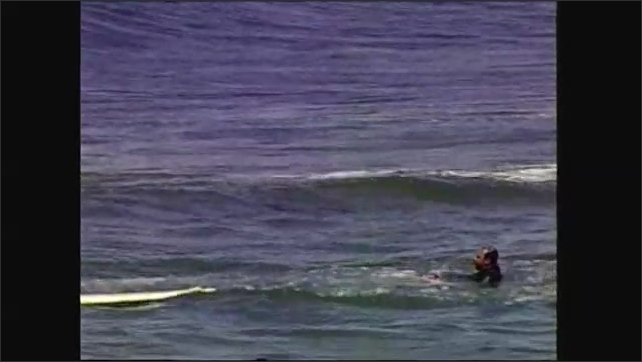 2000s: people surfing on Santa Monica beach, man answering questions about runoff and water pollution