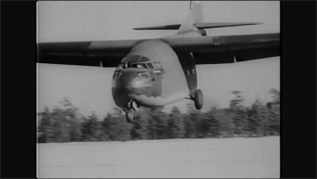 1940s: Glider flying overhead. Glider landing in field. Aerial view of paratroopers dropping from planes. Soldiers jumping from plane.
