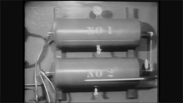 1960s: Man points to safety valve. Man follows tubing through brake system to foot pedal.