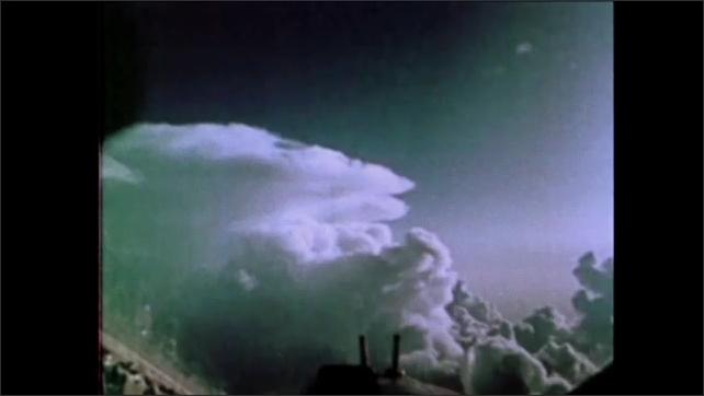 1970s: clouds rapidly approach cockpit window as plane flies through sky