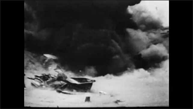 1960s: Man pilots plane.  Plane flies over city and drops bombs.  Explosions.
