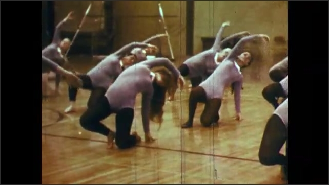 1970s: girls practicing modern dance in studio together