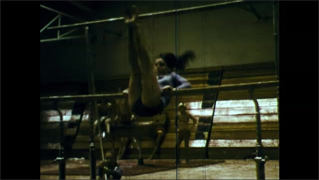 1970s: girls practicing gymnastics on the double bars, girls in a line doing flips