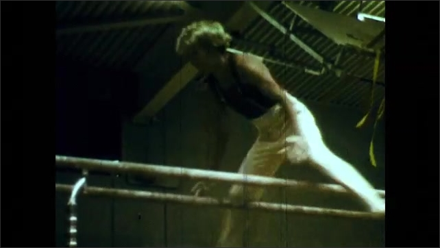 1970s: girl walking on balance beam, girl performing on parallel bars